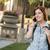 jonge · vrouwelijke · student · lopen · buiten · mobiele · telefoon - stockfoto © feverpitch