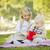 küçük · kız · bebek · kardeş · hediye · park · tatlı - stok fotoğraf © feverpitch