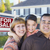 young family in front of for sale sign and house stock photo © feverpitch
