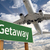 getaway green road sign and airplane above stock photo © feverpitch