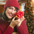 Woman Holding Wrapped Gift in Christmas Setting stock photo © feverpitch
