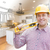 Contractor in Hard Hat Over Custom Kitchen Drawing and Photo stock photo © feverpitch