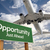 opportunity green road sign and airplane above stock photo © feverpitch