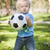 Young Cute Boy Playing with Soccer Ball in Park stock photo © feverpitch