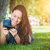 mixed race young female texting on cell phone outside in the gra stock photo © feverpitch