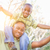 happy african american father and son riding piggyback outdoors stock photo © feverpitch