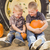 two boys holding pumpkins talking and sitting against tractor ti stock photo © feverpitch