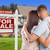 Military Couple Standing in Front of Foreclosure Sign and House stock photo © feverpitch
