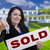 woman holding sold sign and keys in front of house stock photo © feverpitch