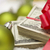 Stack of Hundred Dollar Bills with Bow Near Christmas Ornaments stock photo © feverpitch