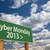 cyber monday 2013 green road sign and clouds stock photo © feverpitch