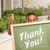 boy giving thumbs up holding thank you chalk board stock photo © feverpitch