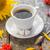 koffiekopje · zwarte · bruin · zonnebloem · witte - stockfoto © fotoaloja