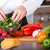 szakács · vág · zöld · uborka · konyha · kezek - stock fotó © fotoedu