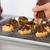 chef decorating some profiteroles stock photo © fotoedu