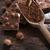 csokoládé · mogyoró · darabok · tej · fa · asztal · sötét - stock fotó © Fotografiche