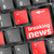 button with breaking news text and letter symbols on the keyboard stock photo © fotoscool
