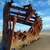 rusty wreckage of a ship on a beach stock photo © frankljr
