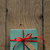 turquoise gift box with red ribbon and vintage style blank tag stock photo © frannyanne