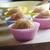 freshly baked cupcakes cooling on wooden chopping board stock photo © frannyanne