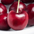 red cherries with stems on white plate stock photo © frannyanne
