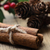 cinnamon sticks bundle holly and fir cones on oak table stock photo © frannyanne