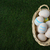 wicker easter egg basket on green grass overhead stock photo © frannyanne