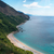 sandy beach surrounded by mountains with a kind on the sea stock photo © frescomovie