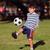 fiatal · srác · futballabda · park · rúg · copy · space · futball - stock fotó © Freshdmedia