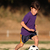 Boy playing soccer in late afternoon light stock photo © Freshdmedia