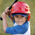 portrait · garçon · batte · de · baseball · rouge · casque · jeunes - photo stock © Freshdmedia