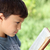 young boy reading book outside stock photo © freshdmedia