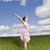 mulher · jovem · em · pé · campo · sorridente · flores - foto stock © gemenacom