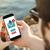 fiatalember · okostelefon · tenger · közelkép · fiatal · kaukázusi - stock fotó © georgejmclittle