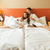young couple lying in the bed of a hotel room stock photo © geribody