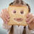 little girl holding in front of his face a happy slice of bread stock photo © geribody