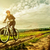 sport bike woman on a meadow with a beautiful landscape stock photo © geribody