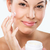 flawless skinned woman with moisturizing face cream stock photo © geribody