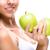 portret · jonge · kaukasisch · vrouw · appels · handen - stockfoto © geribody