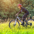 sport bike woman in a beautiful meadow stock photo © geribody