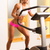 an attractive young woman using a step machine in the gym stock photo © geribody