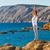 meditál · jóga · tenger · női · ül · óceán - stock fotó © geribody