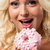 woman happy to eat a pink donut stock photo © giulio_fornasar