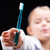 young girl displaying a toothbrush for the camera stock photo © giulio_fornasar