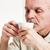 Contented man sipping from tea cup stock photo © Giulio_Fornasar