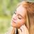 blond · meisje · luisteren · mp3-speler · gelukkig · glimlachend - stockfoto © giulio_fornasar