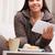 jovem · empresária · trabalhando · café · da · manhã · sofá · sala · de · estar - foto stock © Giulio_Fornasar