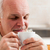 Man with eyes close holding coffee up to his nose stock photo © Giulio_Fornasar