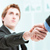 businessmen handshaking with hands in focus stock photo © giulio_fornasar