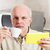 Concerned man holding cup and digital reader stock photo © Giulio_Fornasar